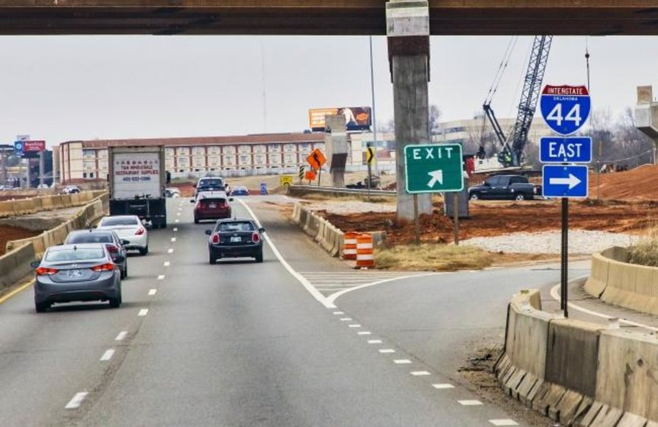 Photo -  The exit to go eastbound on I-44 from northbound I-235 is marked with a new exit sign in Oklahoma City.   [Chris Landsberger/The Oklahoman]