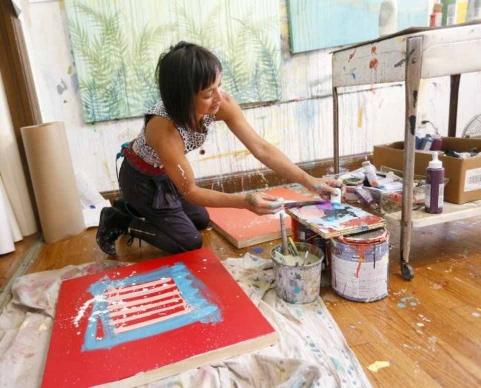 Photo - Local artist Denise Duong paints in her home studio in Oklahoma City, Thursday, May 16, 2019. [Nate Billings/The Oklahoman]