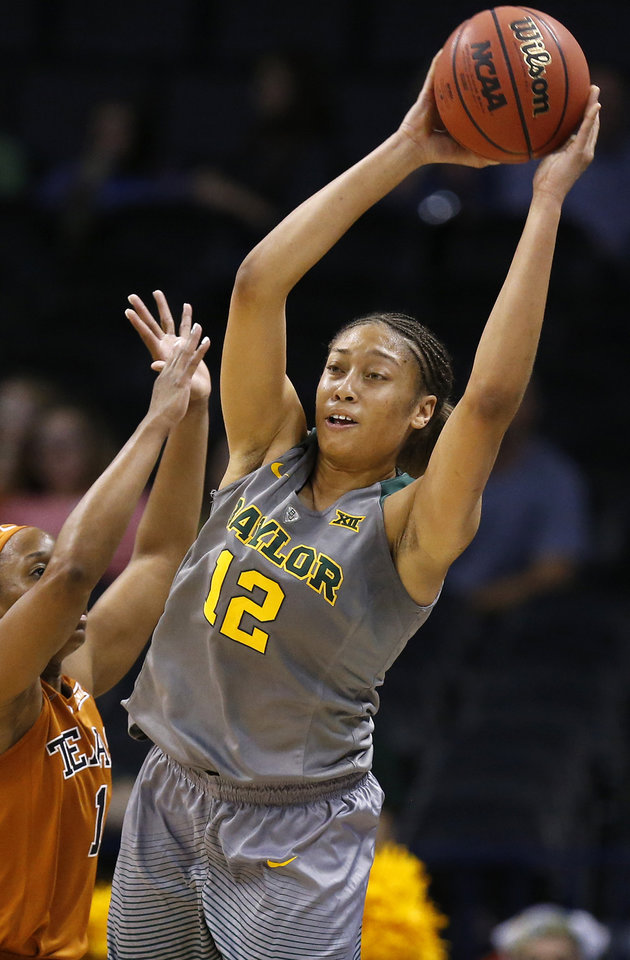 Photo - Baylor's Alexis Prince (12) passes away from Texas' Empress Davenport (1) during the Big 12 Women's Basketball Championship final between the Texas Longhorns and the Baylor Lady Bears at Chesapeake Energy Arena in Oklahoma City, Monday, March 7, 2016. Baylor won 79-63. Photo by Nate Billings, The Oklahoman