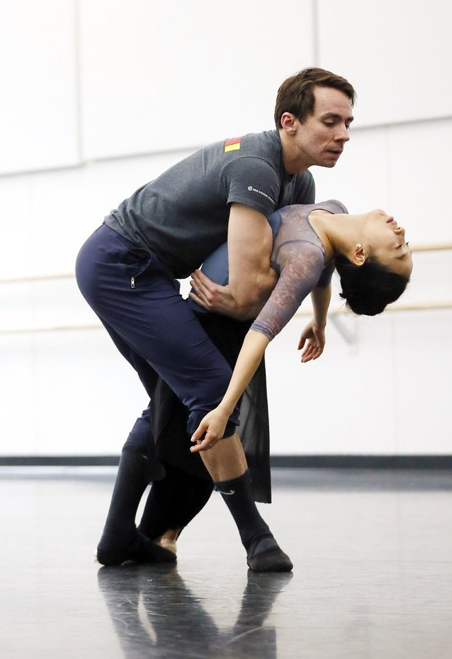 Photo - Principal dancers Alvin Tovstogray, left, and DaYoung Jung rehearse for