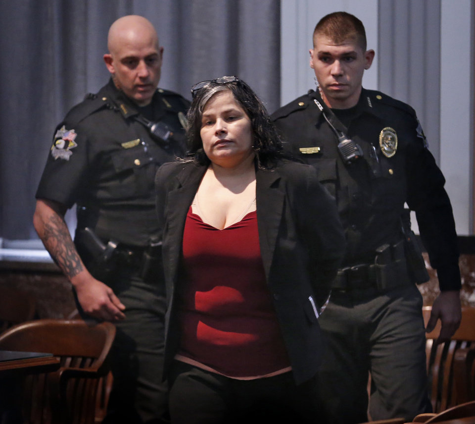 Photo -  Juanita Martinez Gomez is handcuffed Thursday after being convicted of killing her daughter. [Photo by Steve Sisney, The Oklahoman]