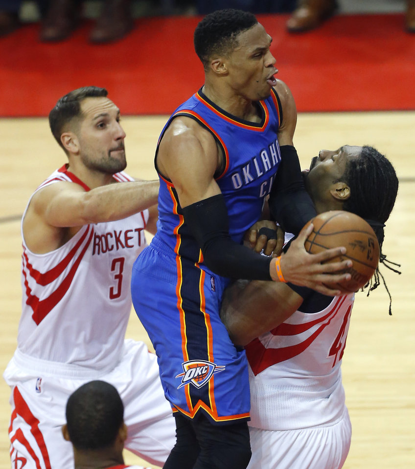 Photo - Oklahoma City's Russell Westbrook (0) goes to the basket as Houston's Ryan Anderson (3) and Nene Hilario (42) defend during Game 2 in the first round of the NBA basketball playoffs between the Oklahoma City Thunder and the Houston Rockets at the Toyota Center in Houston, Texas,  Wednesday, April 19, 2017.  Photo by Sarah Phipps, The Oklahoman
