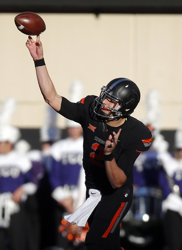 Photo - Oklahoma State's Mason Rudolph throws a pass during a game between the Cowboys and TCU Horned Frogs at Boone Pickens Stadium in Stillwater. (Photo by Sarah Phipps, The Oklahoman)