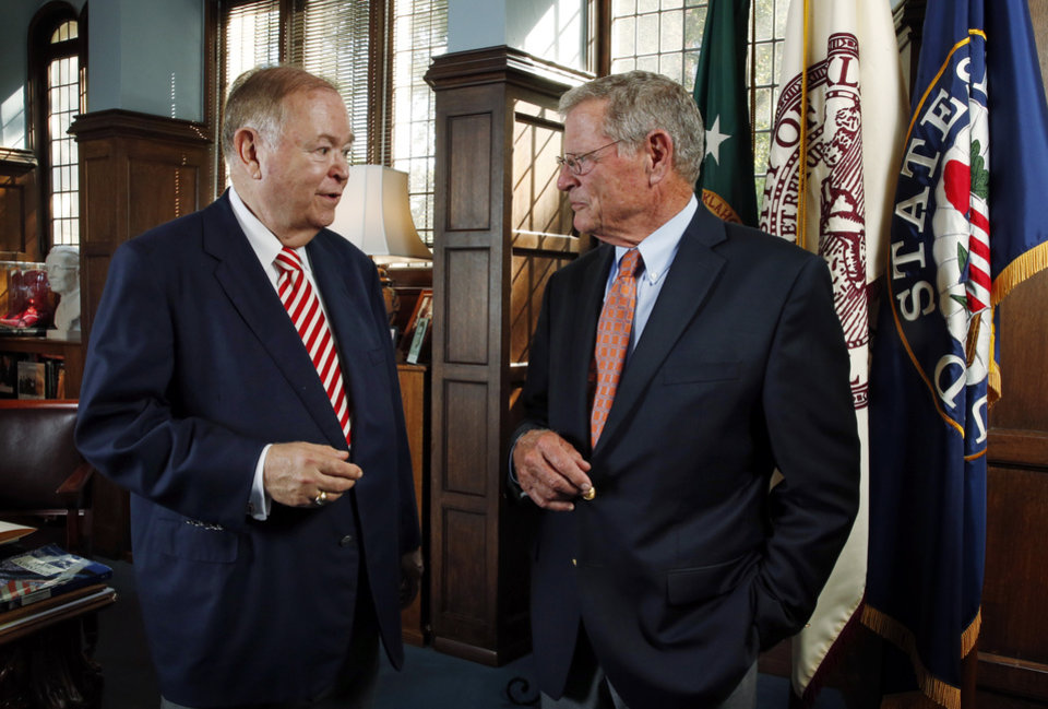 Photo - University of Oklahoma (OU) President David Boren and Senator Jim Inhofe speak in Boren's office on Tuesday, Sept. 30, 2014 in Norman, Okla.  Photo by Steve Sisney, The Oklahoman