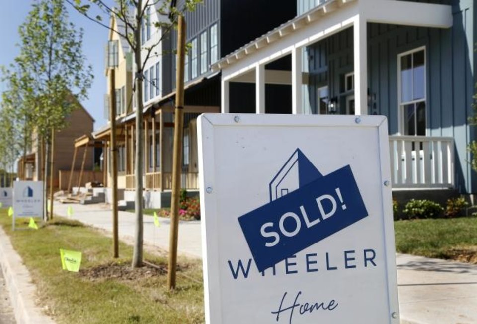 Photo -  The first homes purchased at Wheeler are now home to a mix of families. [JIM BECKEL/THE OKLAHOMAN]