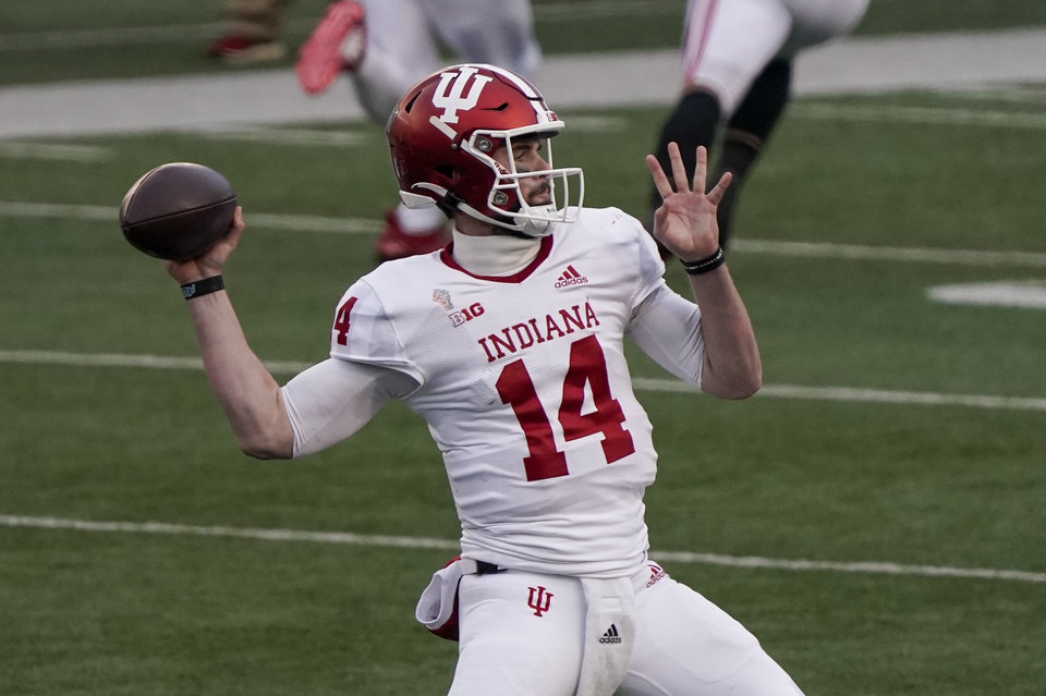 Photo - Indiana's Jack Tuttle throws a pass during the first half of an NCAA college football game against Wisconsin Saturday, Dec. 5, 2020, in Madison, Wis. (AP Photo/Morry Gash)