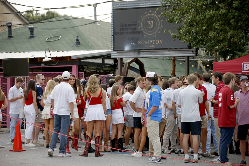 Photo - A crowd stands outside at Campus Corner before a college football game between the University of Oklahoma Sooners (OU) and Missouri State in Norman, Okla., Saturday, Sept. 12, 2020. [Bryan Terry/The Oklahoman]