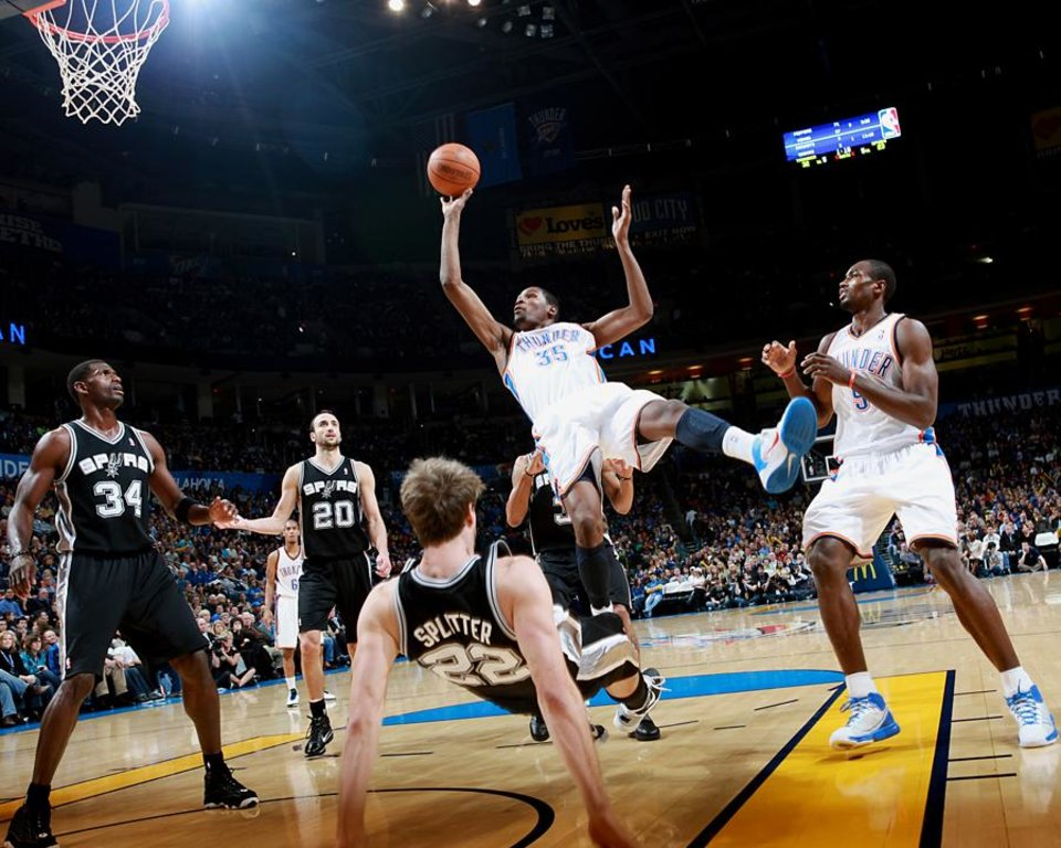 Photo -  Oklahoma City's Kevin Durant puts up a shot and draws a foul from San Antonio's Tiago Splitter during their NBA basketball game in downtown Oklahoma City  on Sunday, Nov. 14, 2010.Photo by John Clanton, The Oklahoman ORG XMIT: KOD