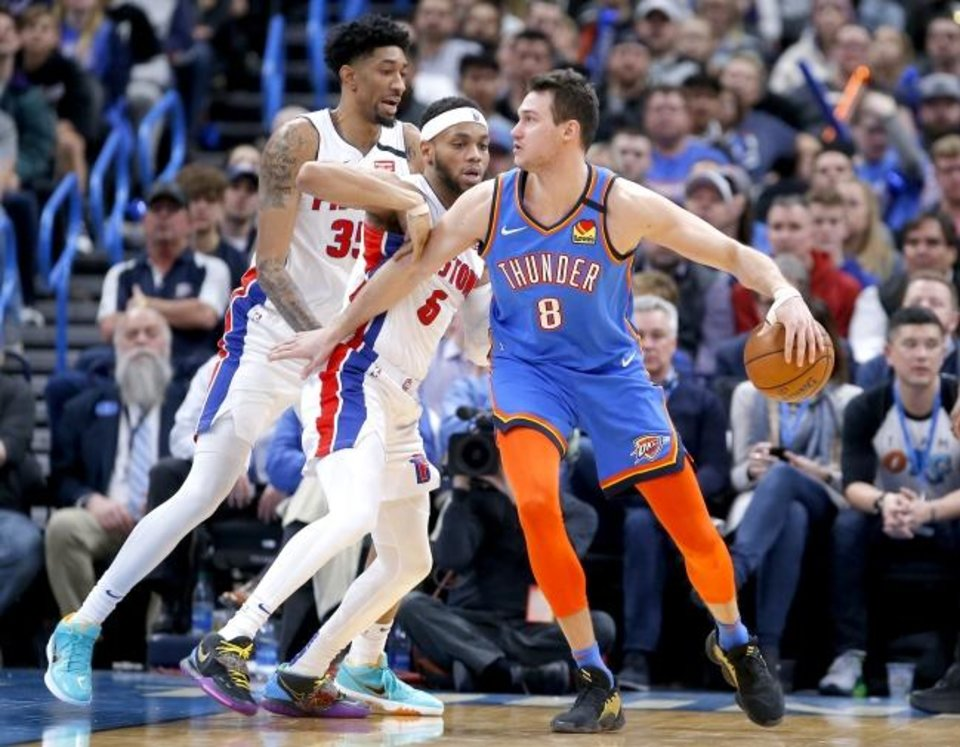 Photo -  Danilo Gallinari (8) looks to get by Detroit's Christian Wood (35) and Bruce Brown (6) during the Thunder's 108-101 win Friday. [Sarah Phipps/The Oklahoman]