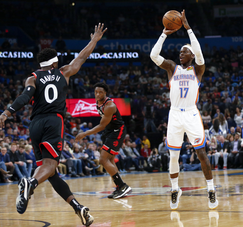 Photo - Oklahoma City's Dennis Schroder (17) shoots near Toronto's Terence Davis II (0), left, and OG Anunoby (3) in the second quarter during an NBA basketball between the Oklahoma City Thunder and the Toronto Raptors at Chesapeake Energy Arena in Oklahoma City, Wednesday, Jan. 15, 2020. [Nate Billings/The Oklahoman]