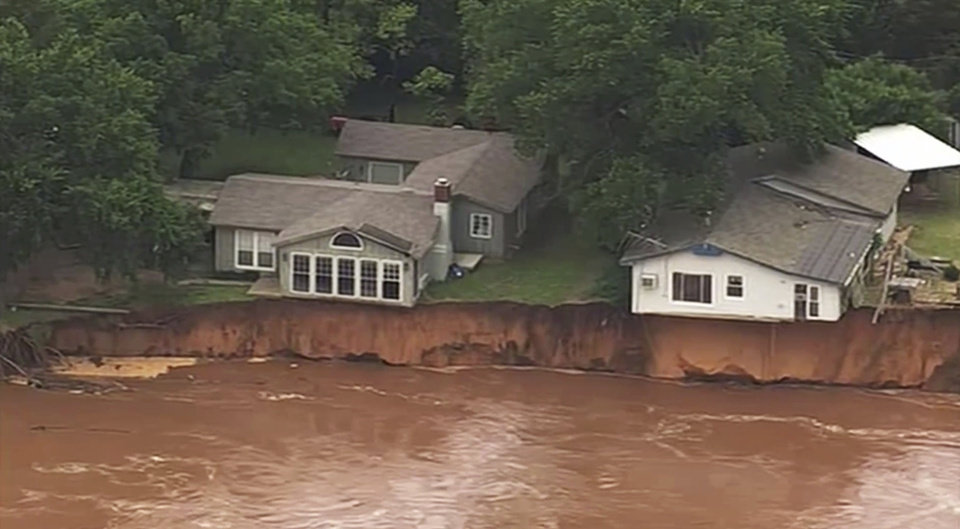 Photo - This image taken from video provided by KOCO-5 shows homes dangerously close to the Cimarron River on Wednesday, May 22, 2019 near Crescent, Oka. Waterlogged parts of the central U.S. were bracing Wednesday for more rain, following days of severe storms that have battered Iowa, Kansas, Missouri and Oklahoma.  (KOCO-5 via AP)