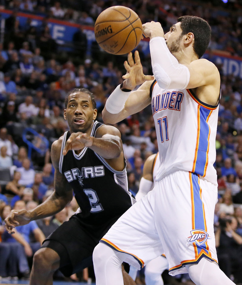 Photo - San Antonio's Kawhi Leonard (2) knocks the ball away from Oklahoma City's Enes Kanter (11) in the second half during an NBA basketball game between the Oklahoma City Thunder and San Antonio Spurs at Chesapeake Energy Arena in Oklahoma City, Friday, March 31, 2017. San Antonio won 100-95. Photo by Nate Billings, The Oklahoman