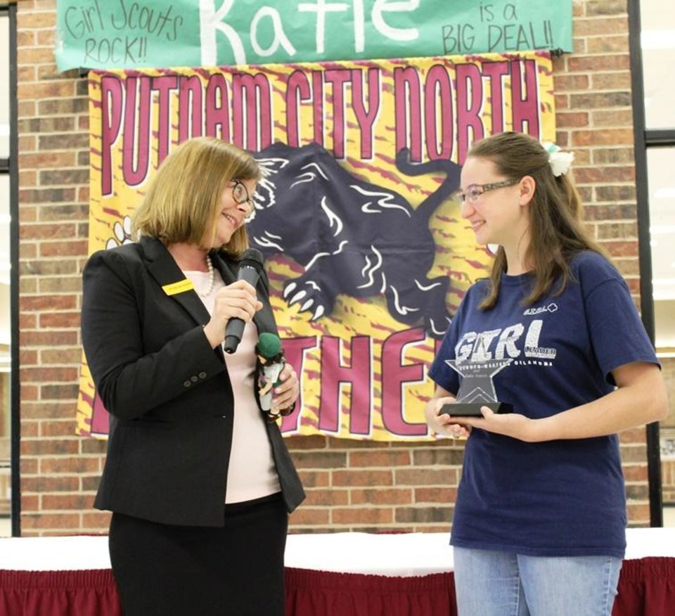 Photo - Oklahoma Girl Scout Katie Francis, right, who this spring broke the record for the most cookies sold over the course of a Girl Scout career, recently got to meet with Elizabeth Brinton, the previous record holder, at a special assembly at Katie's high school, Putnam City North. Photo provided