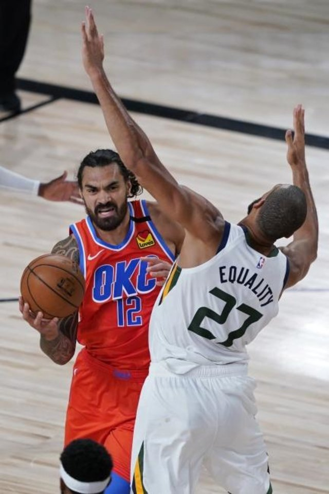Photo -  Jazz center Rudy Gobert (27) fouls his Thunder counterpart, Steven Adams (12), during the first half Saturday. [AP Photo/Ashley Landis, Pool]