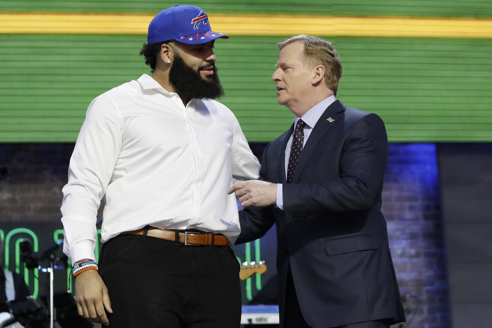 Photo - Oklahoma guard Cody Ford poses with NFL Commissioner Roger Goodell after the Buffalo Bills selected Ford during the second round of the NFL football draft, Friday, April 26, 2019, in Nashville, Tenn. (AP Photo/Mark Humphrey)