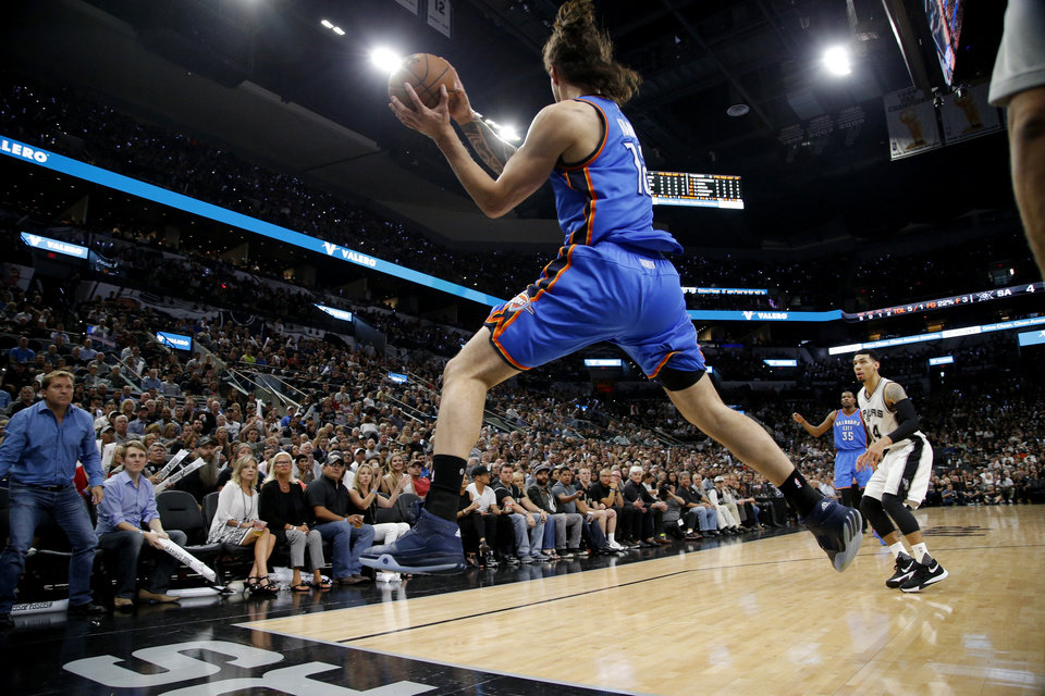 Photo - Oklahoma City's Steven Adams (12) leaps for the ball during Game 5 of the second-round series between the Oklahoma City Thunder and the San Antonio Spurs in the NBA playoffs at the AT&T Center in San Antonio, Tuesday, May 10, 2016. Photo by Bryan Terry, The Oklahoman