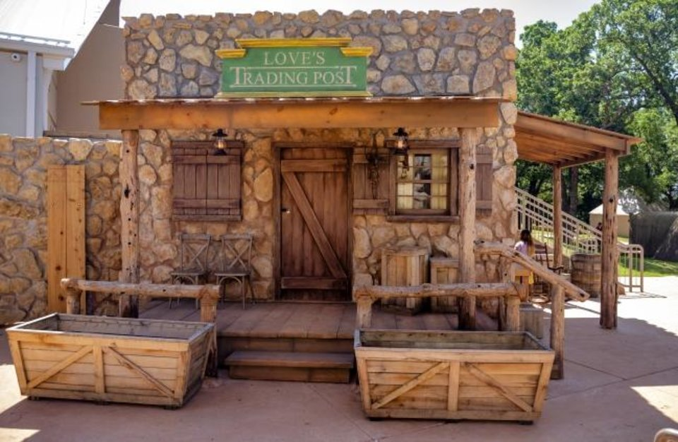 Photo -  A trading post is part of the newly opened Liichokoshkomo', a $15 million outdoor attraction at the National Cowboy & Western Heritage Museum. On May 18, in Oklahoma City, the museum reopened to the public after being closed two months due to the coronavirus pandemic. [Chris Landsberger/The Oklahoman]
