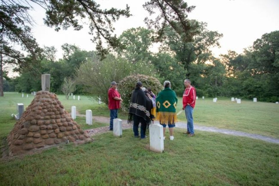 Photo -  Members of the Oklahoma Indian Missionary Conference participate in a prayer vigil at an Apache POW cemetery at Fort Sill in Lawton. [Ginny Underwood/Oklahoma Indian Missionary Conference]