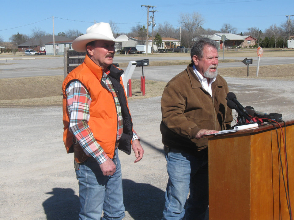 Photo - Comanche County Sheriff Kenny Stradley, left, and OSBI Agent In Charge Richard Goss discuss today's Amber Alert.