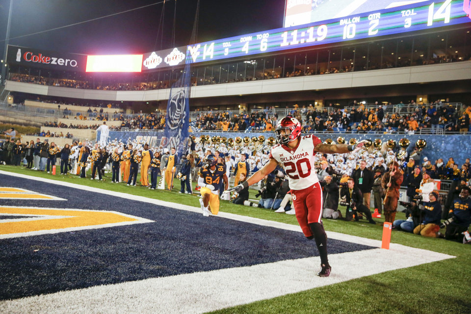 Photo - Oklahoma Sooners safety Robert Barnes (20) signals incomplete pass after West Virginia Mountaineers wide receiver Dominique Maiden (82) fails to catch a touchdown during the NCAA football game between the Oklahoma Sooners and the West Virginia Mountaineers at Mountaineer Field at Milan Puskar Stadium in Morgantown, W.Va on Friday, November 23, 2018. IAN MAULE/Tulsa World