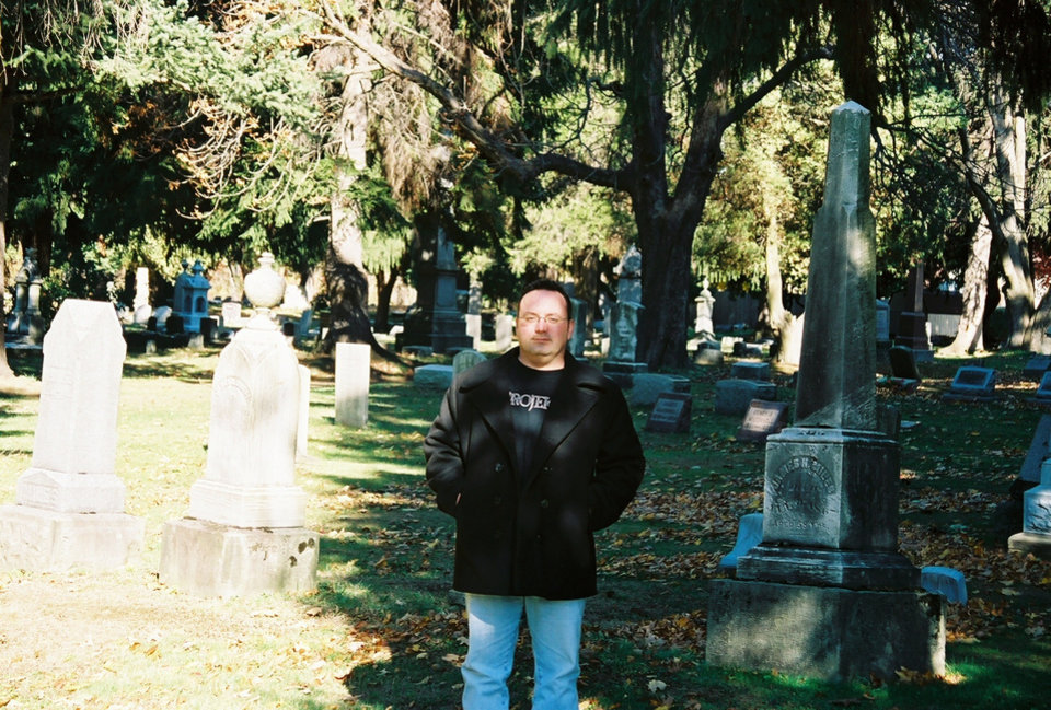 Photo -  Ken Raymond's good friend Jim, posing in a cemetery some years ago.
