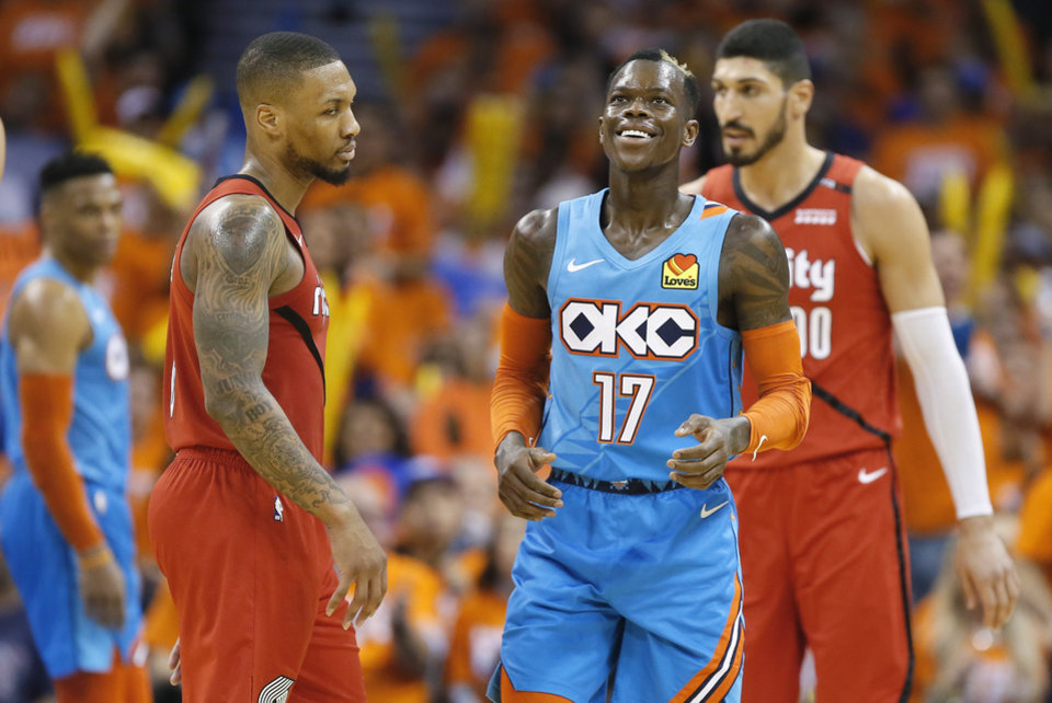Photo - Oklahoma City's Dennis Schroder (17) smiles beside Damian Lillard (0) after a Portland foul during Game 3 in the first round of the NBA playoffs between the Portland Trail Blazers and the Oklahoma City Thunder at Chesapeake Energy Arena in Oklahoma City, Friday, April 19, 2019. Oklahoma City won 120-108. Photo by Bryan Terry, The Oklahoman
