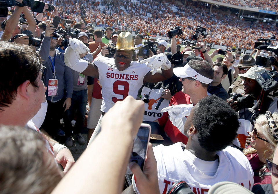 Photo - Oklahoma linebacker Kenneth Murray (9) celebrates with the Golden Hat after the Red River Showdown college football game between the University of Oklahoma Sooners (OU) and the Texas Longhorns (UT) at Cotton Bowl Stadium in Dallas, Saturday, Oct. 12, 2019. Oklahoma won 34-27. [Bryan Terry/The Oklahoman]
