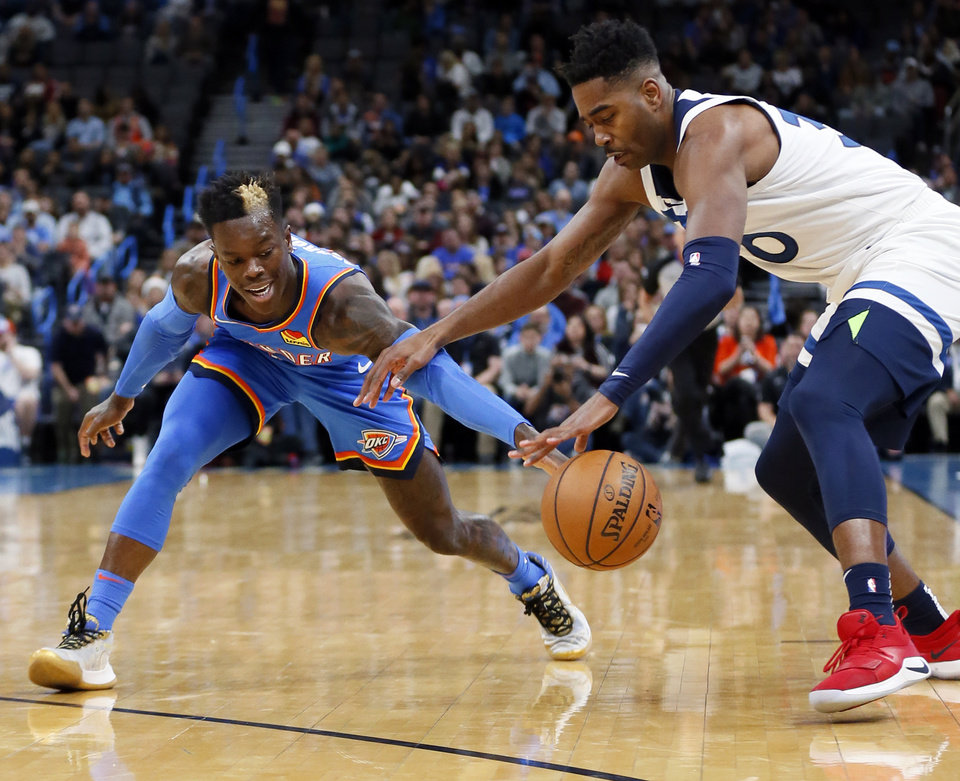 Photo - Minnesota's Kelan Martin (30), right, tries to steal the ball from Oklahoma City's Dennis Schroder (17) in the first quarter during an NBA basketball game between the Minnesota Timberwolves and the Oklahoma City Thunder at Chesapeake Energy Arena in Oklahoma City, Friday, Dec. 6, 2019. [Nate Billings/The Oklahoman]