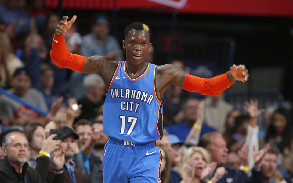Photo - Oklahoma City's Dennis Schroder (17) celebrates a 3-point basket during the NBA game between the Oklahoma City Thunder and the Utah Jazz at the Chesapeake Energy Arena, Friday, Feb. 22, 2019. Photo by Sarah Phipps, The Oklahoman