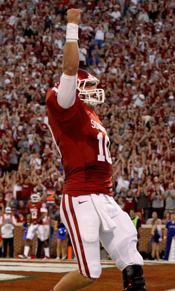 Photo - OU's Blake Bell (10) celebrates after a touchdown during the college football game between the University of Oklahoma Sooners (OU) and the Kansas Jayhawks (KU) at Gaylord Family-Oklahoma Memorial Stadium in Norman, Okla., Saturday, Oct. 20, 2012. Photo by Bryan Terry, The Oklahoman