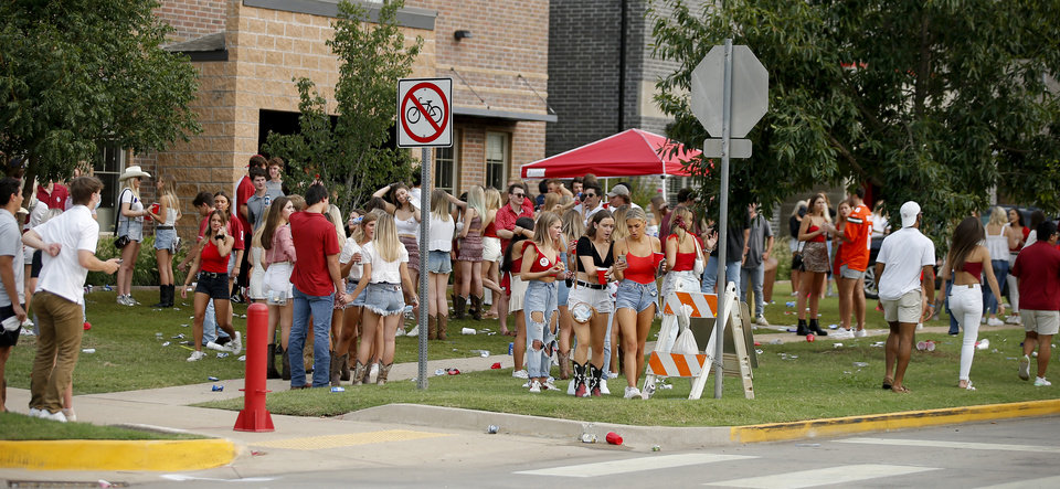Photo - A crowd gathers off campus during a college football game between the University of Oklahoma Sooners (OU) and Missouri State in Norman, Okla., Saturday, Sept. 12, 2020. [Bryan Terry/The Oklahoman]