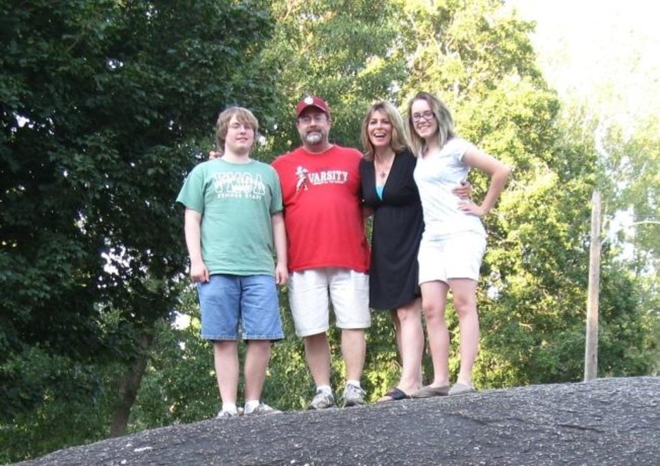 Photo -  From left: The Mitchell family — Clayton, Lee, Kari and Hannah. Lee, who died last month,