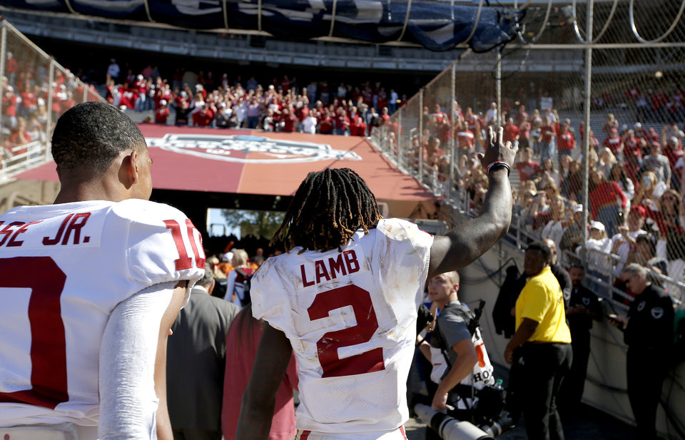 Photo - Oklahoma's CeeDee Lamb (2) waves to fans following the Red River Showdown college football game between the University of Oklahoma Sooners (OU) and the Texas Longhorns (UT) at Cotton Bowl Stadium in Dallas, Saturday, Oct. 12, 2019. OU won 34-27. [Sarah Phipps/The Oklahoman]