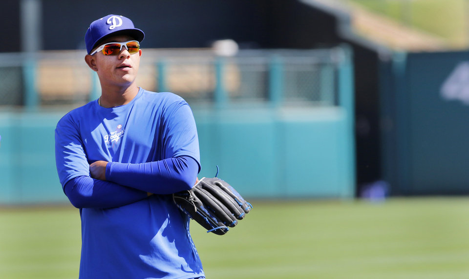 Photo - Oklahoma City Dodgers' Julio Urias during practice at Chickasaw Bricktown Ballpark in Oklahoma City, Tuesday April 5, 2016. Photo By Steve Gooch, The Oklahoman