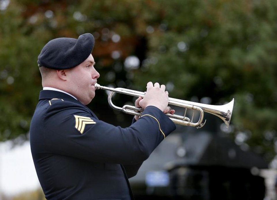Photo - A member of the 145th Army Band, Oklahoma National Guard, performs during the Veterans Day Service at the 45th Infantry Division Museum in Oklahoma City, Saturday, Nov. 11, 2017. [Photo by Sarah Phipps/The Oklahoman Archives]