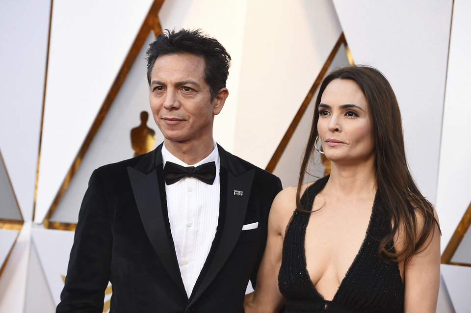 Photo - Benjamin Bratt, left, and Talisa Soto arrive at the Oscars on Sunday, March 4, 2018, at the Dolby Theatre in Los Angeles. (Photo by Jordan Strauss/Invision/AP)