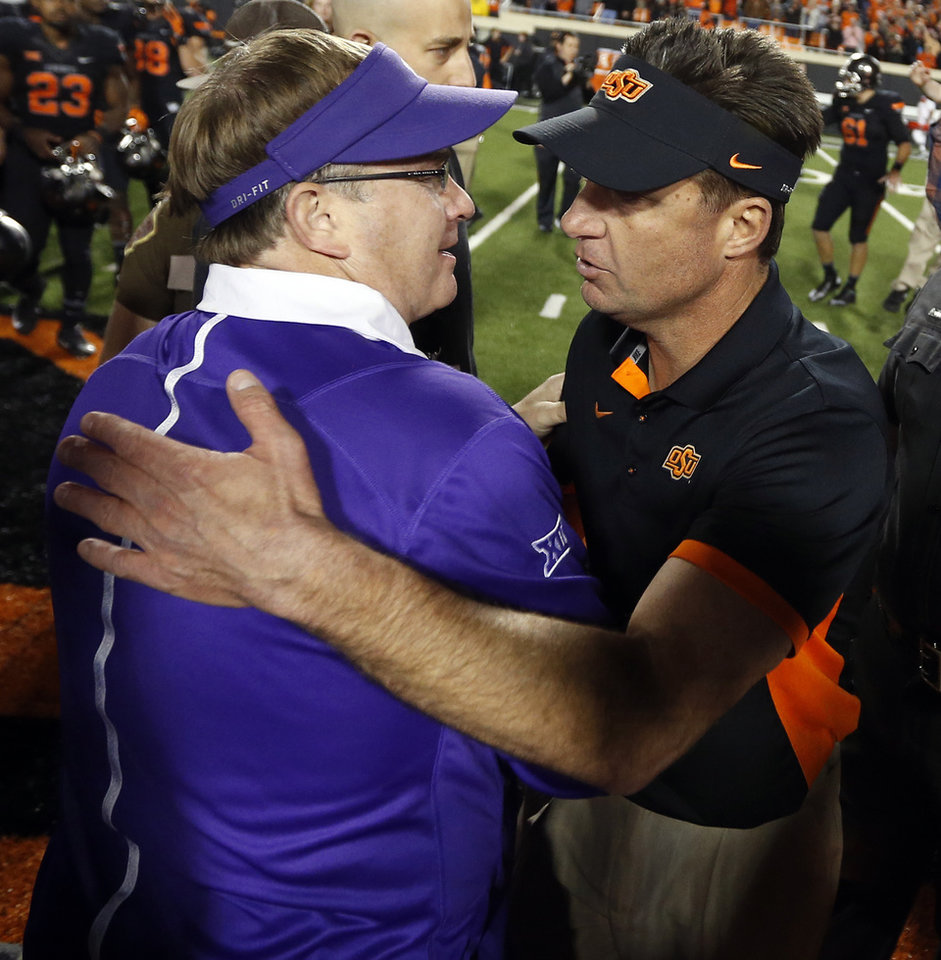 Photo - TCU coach Gary Patterson, left, and Oklahoma State coach Mike Gundy talk after the college football game between the Oklahoma State Cowboys (OSU) and TCU Horned Frogs at Boone Pickens Stadium in Stillwater, Okla., Saturday, Nov. 7, 2015. OSU won 49-29. Photo by Nate Billings, The Oklahoman