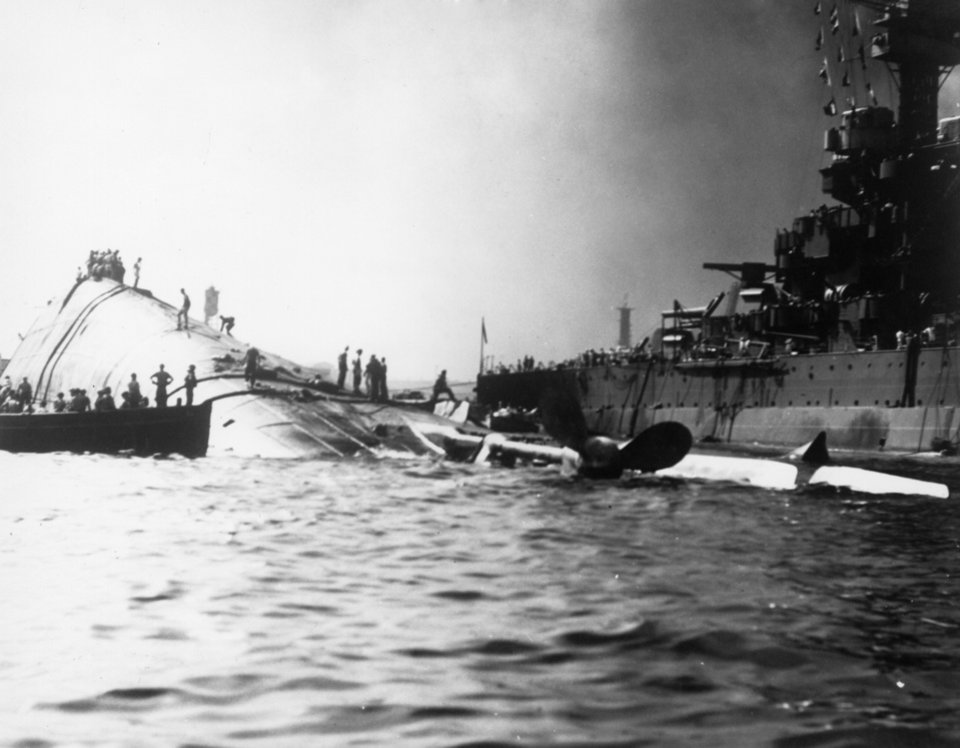 Photo -  The USS Oklahoma was capsized in the Japanese attack on Pearl Harbor on Dec. 7, 1941. The photographer is unknown. Photo credited to the National Archives. Photo undated and published on April 24, 1994, in The Daily Oklahoman.  UNKNOWN