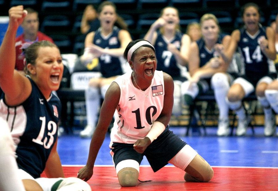Photo -  UCO / U.S. / USA / UNITED STATES / CELEBRATION: USA's Kari Miller (10) and Nichole Millage celebrates a point during the 2010 Sitting Volleyball World Championships Women's gold medal match between USA and China, Sunday, July 18, 2010, at the University of Central Oklahoma, in Edmond, Okla. Photo by Sarah Phipps, The Oklahoman.      ORG XMIT: KOD