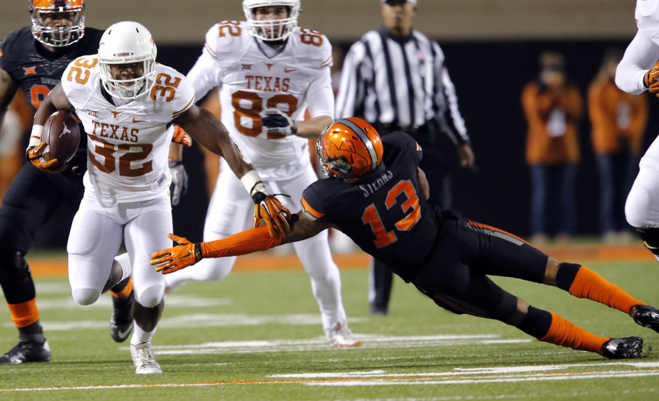 Photo - Texas' Johnathan Gray (32) runs past Oklahoma State's Jordan Sterns (13) during the college football game between the Oklahoma State University Cowboys (OSU) the University of Texas Longhorns (UT) at Boone Pickens Staduim in Stillwater, Okla. on Saturday, Nov. 15, 2014.  Photo by Chris Landsberger, The Oklahoman