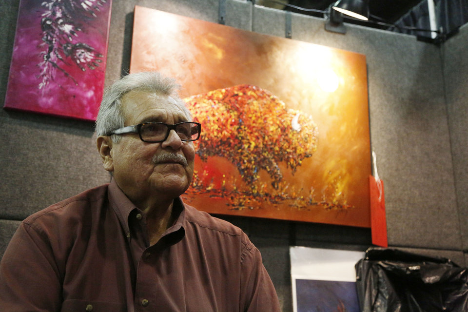Photo - Clancy Gray, 2019 Red Earth Honored One, talks with a reporter during at the first day of the 2019 Red Earth Festival at the Cox Convention Center in Oklahoma City, Oklahoma Friday, June 7, 2019.  [Paxson Haws/The Oklahoman]