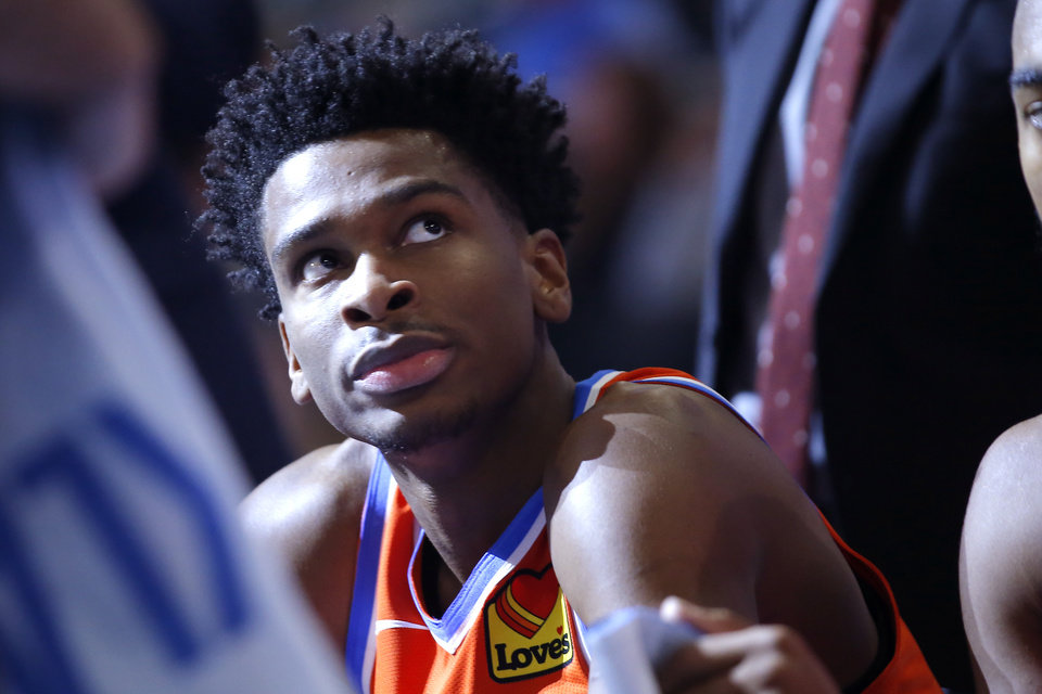 Photo - Oklahoma City's Shai Gilgeous-Alexander (2) looks up during a timeout in an NBA basketball game between the Oklahoma City Thunder and the LA Clippers at Chesapeake Energy Arena in Oklahoma City, Sunday, Dec. 22, 2019. Oklahoma City won 118-112. [Bryan Terry/The Oklahoman]