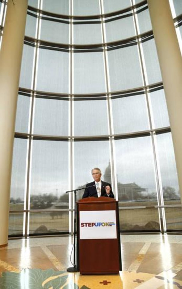 Photo -  David Rainbolt, an Oklahoma banker, discusses a proposed package of reforms developed by a coalition of Oklahoma business and civic leaders during a news conference Thursday in the atrium of the Oklahoma History Center.  [Photo by Jim Beckel, The Oklahoman]