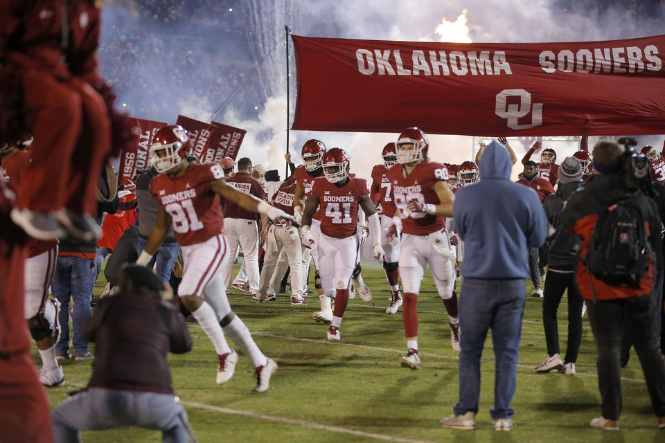 Photo - Oklahoma takes the field before a college football game between the University of Oklahoma Sooners (OU) and the Kansas Jayhawks (KU) at Gaylord Family-Oklahoma Memorial Stadium in Norman, Okla., Saturday, Nov. 17, 2018. Photo by Bryan Terry, The Oklahoman