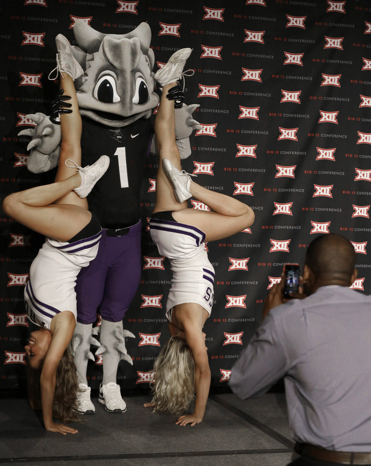 Photo - TCU cheerleaders pose for a photo on the main stage with the schools' mascot during the NCAA college Big 12 Conference football media days in  Dallas, Monday, July 21, 2014. (AP Photo/LM Otero)