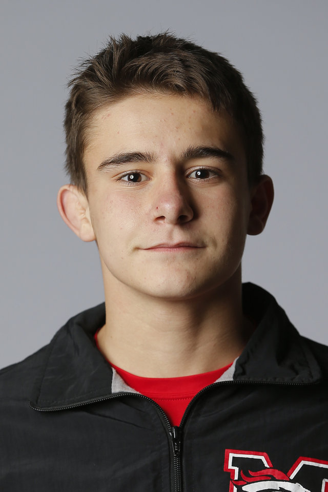 Photo - Mustang wrestler Tucker Owens poses for a photo during The Oklahoman's photo day for winter sports at Bishop McGuinness in Oklahoma City, Wednesday, Nov. 14, 2018. [Photo by Bryan Terry/The Oklahoman]