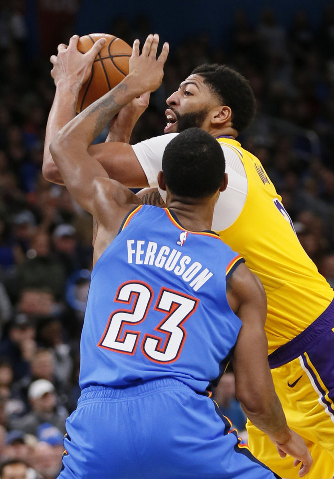 Photo - Los Angeles' Anthony Davis (3) draws the foul from Oklahoma City's Terrance Ferguson (23) in the fourth quarter during an NBA basketball game between the Oklahoma City Thunder and the Los Angeles Lakers at Chesapeake Energy Arena in Oklahoma City, Friday, Nov. 22, 2019. The Lakers won 130-127. [Nate Billings/The Oklahoman]
