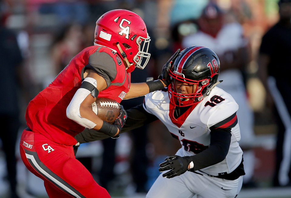 Photo - Carl Albert's Jayveion Traylor gets by Del City's Jay Fuentes as he returns the opening kick off for a touchdown during the high school football game between Carl Albert and Del City at Carl Albert High School in Midwest City, Okla., Friday, Sept. 13, 2019. [Sarah Phipps/The Oklahoman]