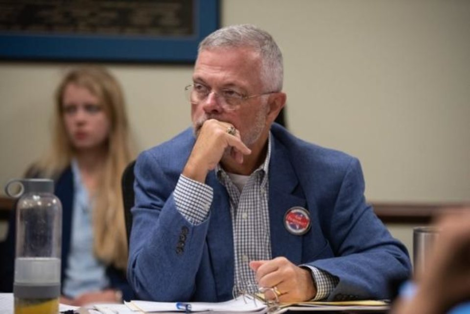 Photo -  Trent Baggett, District Attorneys Council executive coordinator, listens to a presentation during the May 16 District Attorneys Council meeting. [Whitney Bryen/Oklahoma Watch]
