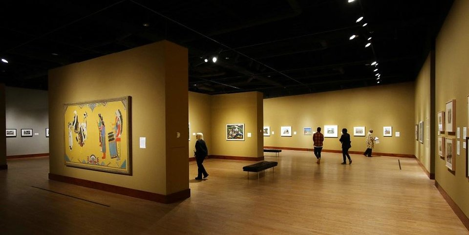 Photo - Visitors look at artworks in the Oklahoma City Museum of Art exhibit